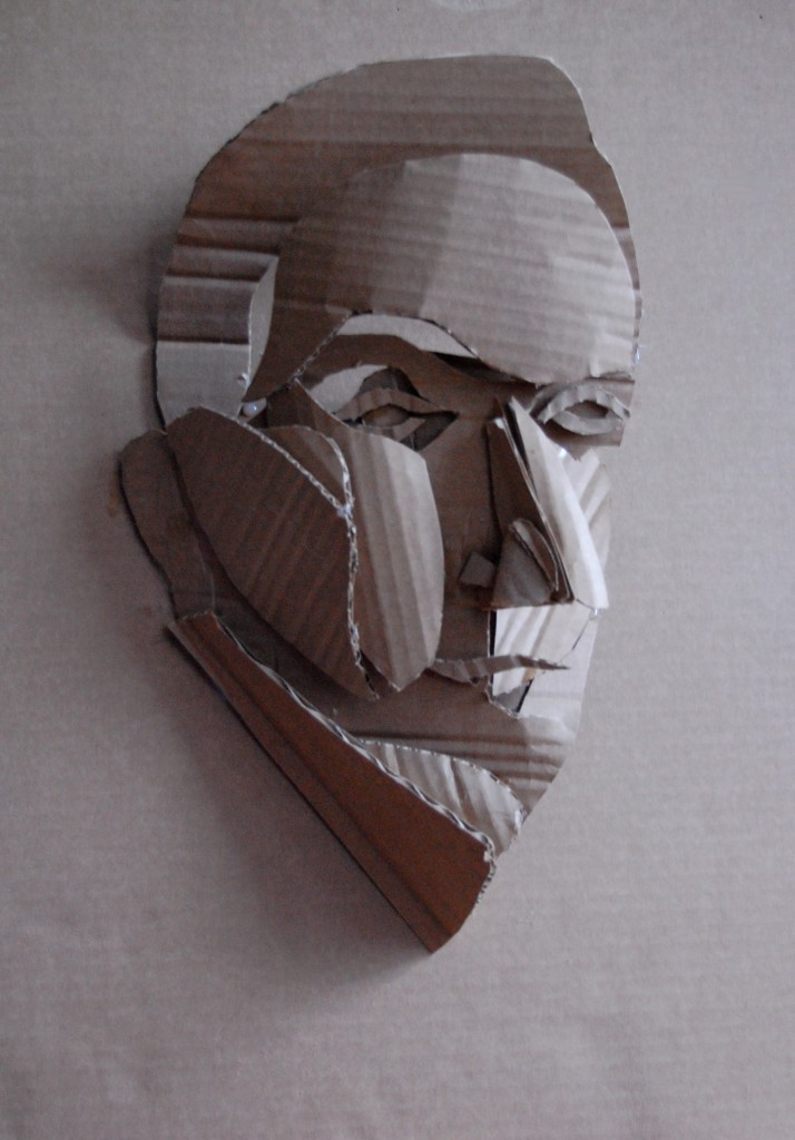 "Gwen Kehrig-Darton. Corrugated Man. Corrugated cardboard and glue. 17.25"" x 24.325"". 2009."