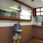 Kathleen waiting for food order by Lori Nix